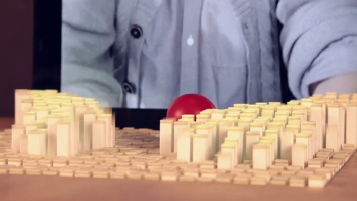 Screenshot of inFORM's demo video (http://tangible.media.mit.edu/project/inform/)