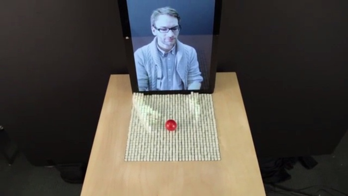 Screenshot of inFORM's demo video (http://tangible.media.mit.edu/project/inform/)