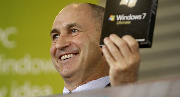 Chris Liddell, CFO of Microsoft Corp., holds up a copy of the Windows 7 computer operating system during a rally to celebrate the release of Windows 7 at the Microsoft Campus Thursday, Oct. 22, 2009, in Redmond, Wash. During the gathering Liddell pushed a button to officially start the NASDAQ stock market trading day.(AP Photo/Ted S. Warren)