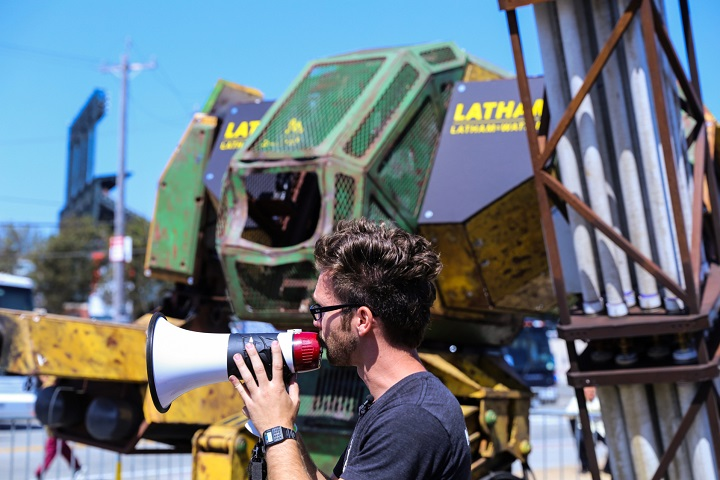 The MegaBot MKII in the background (Image Source: techcrunch)