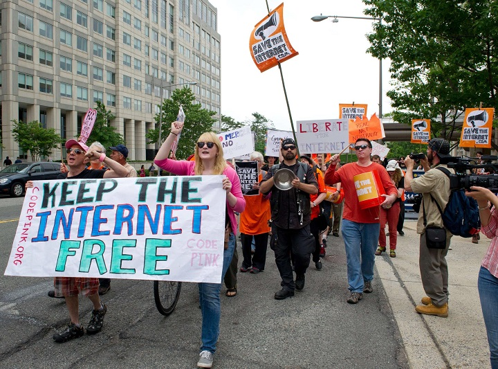 Protest over net neutrality being axed. (Image Source: NBC News)